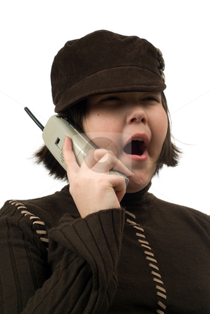 Boring Conversation stock photo, A young girl yawning at a boring conversation she is having on a cordless phone, isolated against a white background by Richard Nelson
