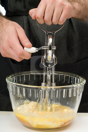 Mixing Cookie Batter stock photo, A young chef using a hand beater to mix some cookie batter by Richard Nelson