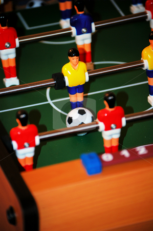 Foosball table stock photo, Foosball table with a score about to happen by Tim Markley