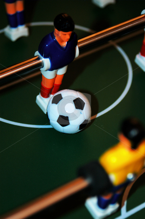 Who's the man stock photo, Man in a blue top on a foosball game by Tim Markley