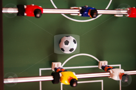 Rolling ball stock photo, Rolling ball on a foosball table by Tim Markley