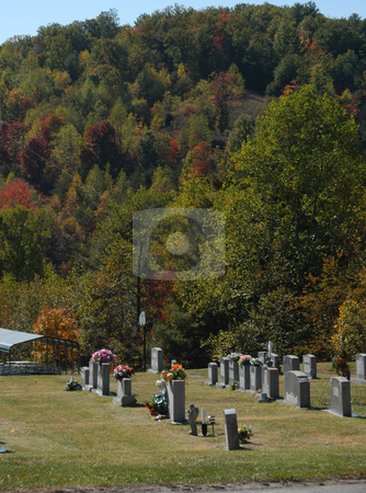 Mountain graves stock photo, A cemetary near a small mountain by Tim Markley
