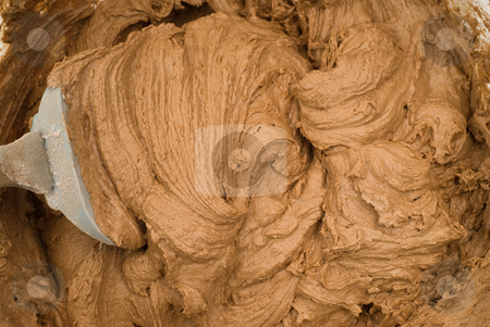 Cookie Batter stock photo, Closeup view of some chocolate cookie batter, with a spatula in it by Richard Nelson