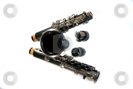 Clarinet stock photo, Black B Clarinet on white background in pieces. by Henrik Lehnerer