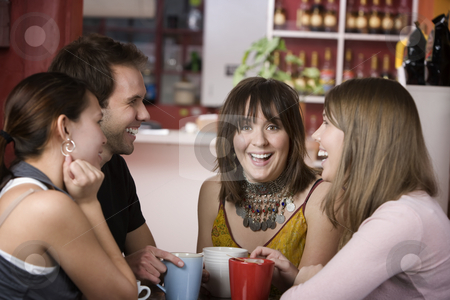 Pretty Young Woman Surrounded by Friends stock photo, Pretty Young Woman Surrounded by Friends in a Coffee House by Scott Griessel