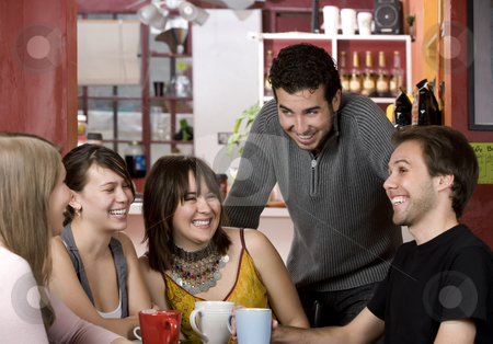 Friends in a Coffee House stock photo, Five young friends in a coffee house by Scott Griessel