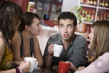 Handsome Young Man Surrounded by Women stock photo, Handsome young man in a coffee house surrounded by pretty women by Scott Griessel