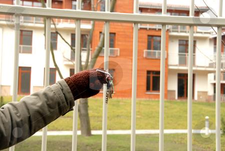 Key stock photo, Woman holding a key for a house by Joanna Szycik