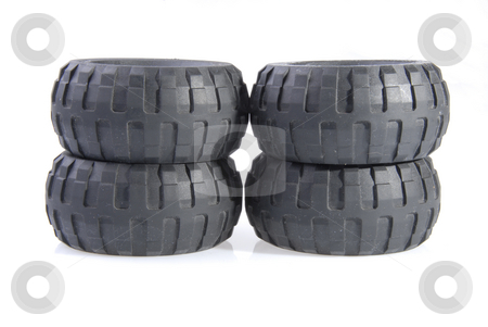 Tyres stock photo, 3D tires stacked up and isolated on white background by Joanna Szycik