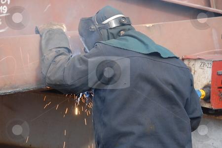 Welding stock photo, Worker welding steel in a mechanical workshop by Joanna Szycik