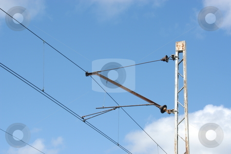 Electrical train wires stock photo, Electrical overhead train wires details closeup on couldy sky by Joanna Szycik
