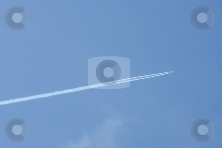 Jet plane in the sky stock photo, Jet plane in the sky with traces by Joanna Szycik