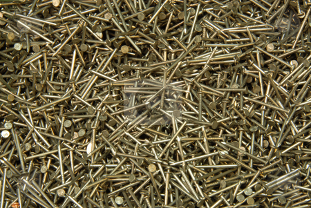 Nails stock photo, The heap of nails lays on a surface by Joanna Szycik