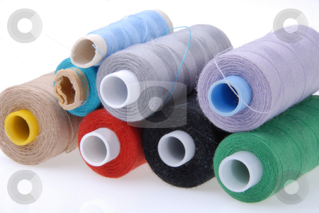 Spools stock photo, Many colorful spools of thread: red, blue, black by Joanna Szycik