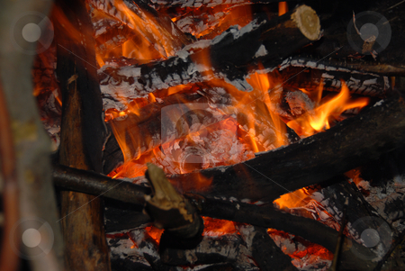 HOT COALS stock photo, A close up view of hot coals in the middle of a burning wood fire. by Joanna Szycik