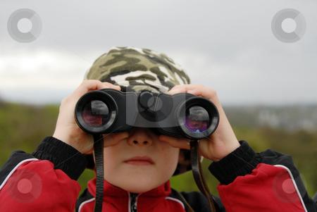 Boy observing nature through binoculars stock photo, Boy watching with binoculars to the horizon by Joanna Szycik