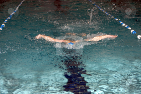 Butterfly swimmer stock photo, Young male swimmer swimming butterfly stroke - swimming pool by Joanna Szycik