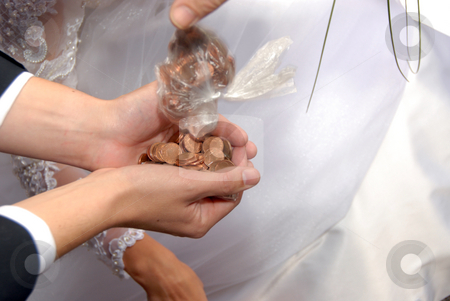 Wedding coins stock photo, Some golden coins in hands after wedding by Joanna Szycik