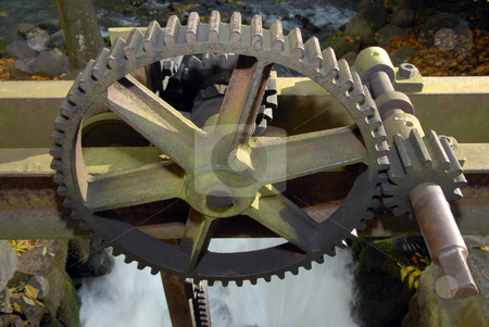 Steely gears stock photo, Old steam engine with inactive rusty steely gears by Joanna Szycik