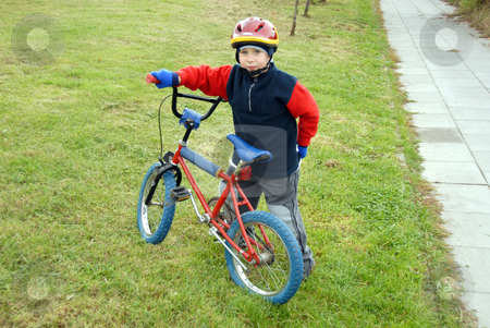 Boy and bicycle stock photo, The young boy and a littel bicycle by Joanna Szycik