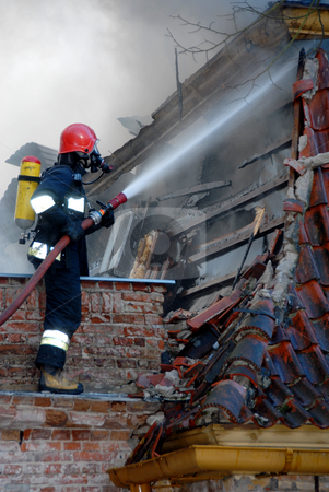 Fireman stock photo, Firemen on a roof during a house fire. by Joanna Szycik