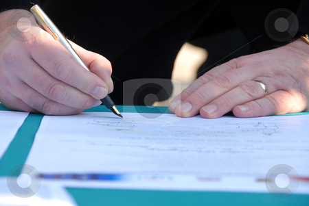 Businessman is signing a contract stock photo, Businessman is signing an agreement of a important deal or contract by Joanna Szycik