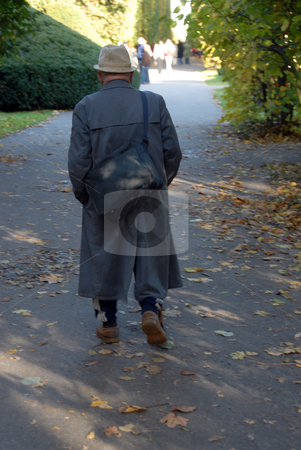 Senior walk in park stock photo, Male senior are going for a walk by Joanna Szycik