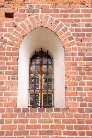 Window in an Malbork csatle stock photo, A gothic style window in an Malbork csatle by Joanna Szycik