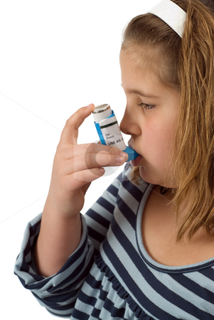 Bronchodilator stock photo, A young child using her bronchodilator to treat her asthma by Richard Nelson