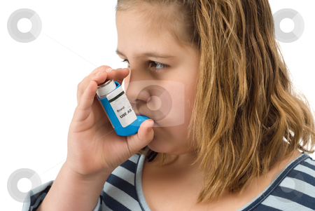 Girl Taking Inhaler stock photo, A young child taking her asthma inhaler, isolated against a white background by Richard Nelson