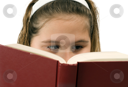 Girl Reading stock photo, A young child reading a book, isolated against a white background by Richard Nelson