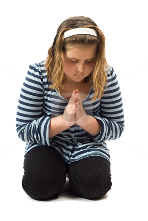 Young Girl Praying stock photo, Young girl on her knees praying, isolated against a white background by Richard Nelson