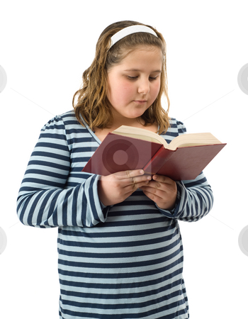 Young Girl Reading stock photo, A young girl reading a book, isolated against a white background by Richard Nelson