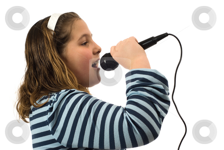Child Singing In Microphone stock photo, A young girl singing into a microphone, isolated against a white background by Richard Nelson