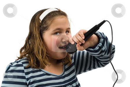 Karaoke Child stock photo, Closeup view of a young girl singing karaoke into a microphone, isolated against a white background by Richard Nelson