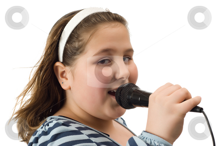 Closeup Child Singing stock photo, Closeup view of a young girl singing into a microphone, isolated against a white background by Richard Nelson