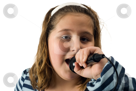 Singing Girl stock photo, A young female child singing into a microphone, isolated against a white background by Richard Nelson