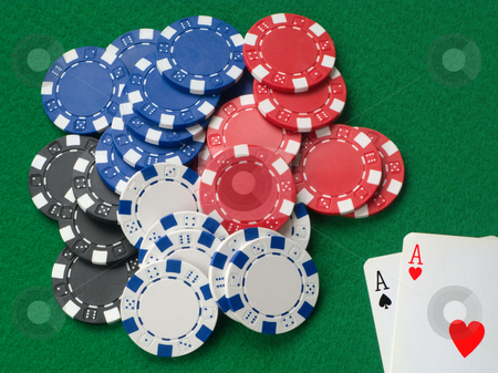 Two aces winning lots of poker chips. stock photo, Two aces winning lots of poker chips. by Stephen Rees