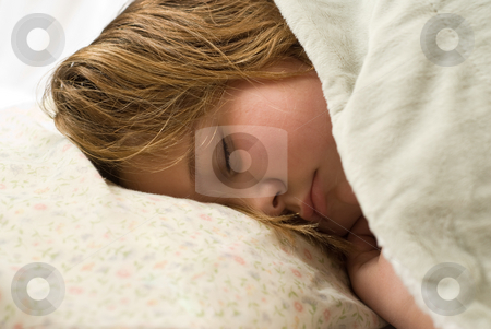 Bedtime stock photo, A young girl lying down on a pillow by Richard Nelson