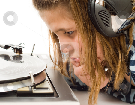 Child Watching Record Player stock photo, A young girl listening to music on an old record player by Richard Nelson