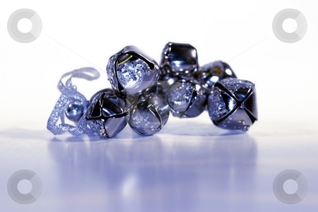 Bells stock photo, Silver shiny bells in a group on white background by Henrik Lehnerer