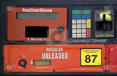 Gas Pump stock photo, Closeup of an old gas pump advertising the current price on the digital lcd. by Todd Arena