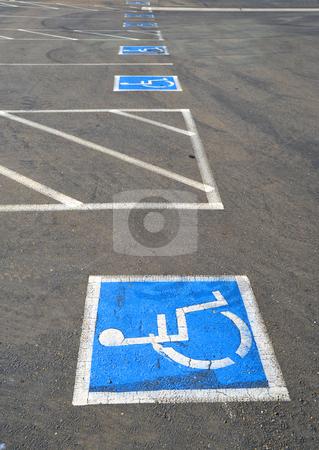 Handicap Parking Spaces stock photo, Multiple empty handicap parking spaces in an asphalt parking lot by Lynn Bendickson