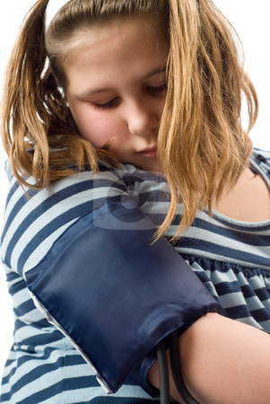 Blood Pressure stock photo, A young girl look at a blood pressure cuff on her arm by Richard Nelson