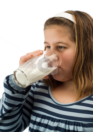 Child Drinking Milk stock photo, A young female child drinking a glass of milk, isolated against a white background by Richard Nelson