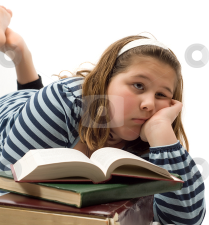 Bored of Studying stock photo, Young girl looks tired of studying her text books, isolated against a white background by Richard Nelson