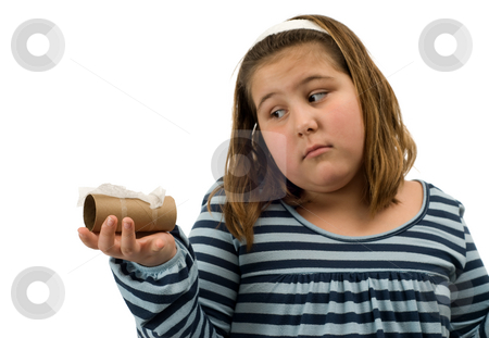 Out Of Toilet Paper stock photo, A young girl holding an empty roll of toilet paper, isolated against a white background by Richard Nelson