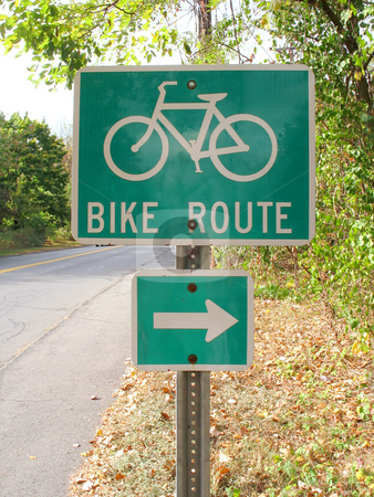 Bike route stock photo, A green bike route sign on the side of the road by Todd Arena