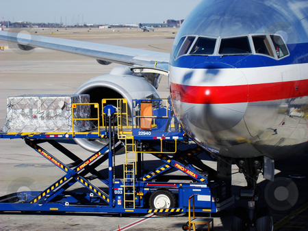 Air transportation stock photo, Aircraft loading cargo at International airport. by Fernando Barozza