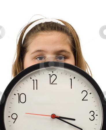 Girl Hiding Behind Clock stock photo, Young girl hiding behind a large wall clock, isolated against a white background by Richard Nelson